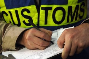 800px US Navy 061209 N 8148A 067 A customs border clearance agent assigned to Navy Customs Battalion Romeo keeps record of each inspection